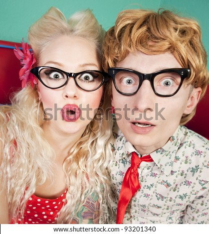 Funny surprised nerdy couple