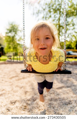 funny swinging little cute smiling kid - stock photo