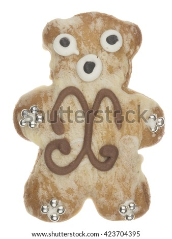 funny tasty gingerbread teddy bear pattern and decorated with silver sugar balls isolated on white background - stock photo