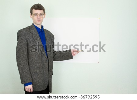 Funny teacher telling about something and showing on the poster - stock photo
