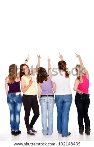 funny teenager girls pointing in copy space above them showing, - stock photo
