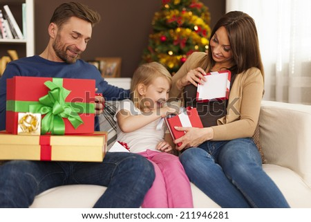 Funny time during opening christmas gifts - stock photo