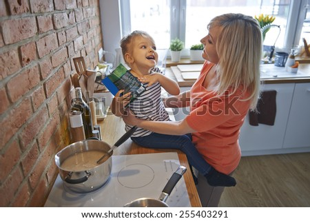 Funny time with grandma in the kitchen  - stock photo
