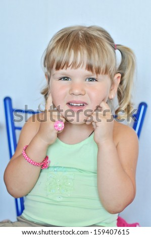 funny toddler wearing ring and bracelet