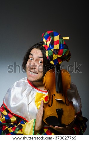 Funny violin clown player in musical concept