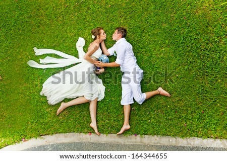 Funny wedding games on a grass - stock photo