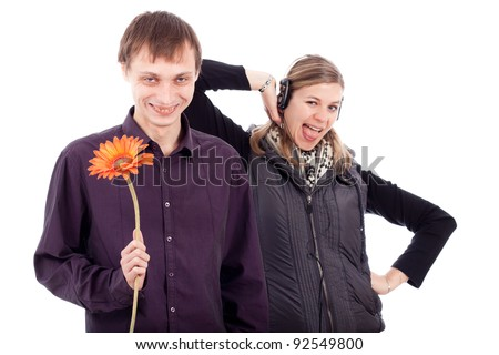 Funny weird couple, ugly man holding flower and rebel woman, isolated on white background. - stock photo