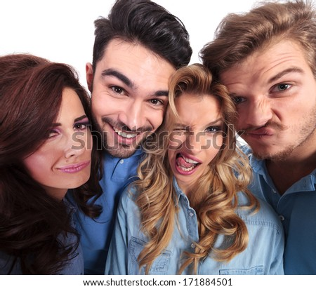 funny wide angle picture of casual people fooling around and making faces  - stock photo
