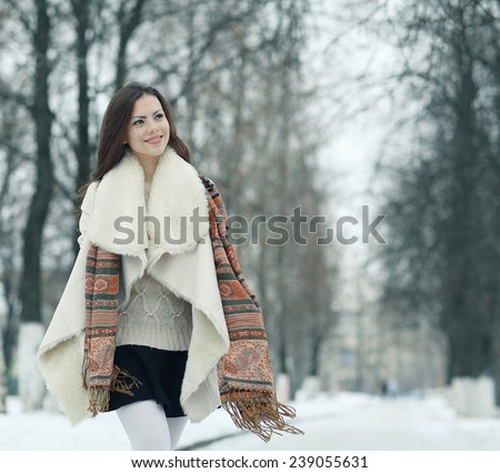 funny winter pictures running and jumping girl - stock photo