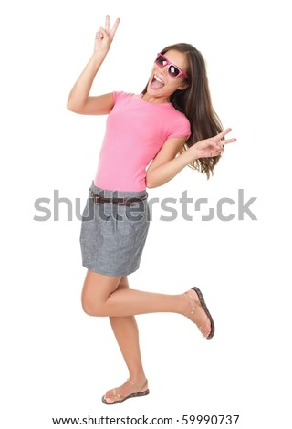 Funny woman dancing showing victory hand sign wearing cheap red sunglasses. Asian / Caucasian model isolated on white background in full length. - stock photo