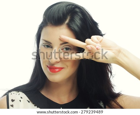 Funny woman doing hand sign. Studio shot.  - stock photo