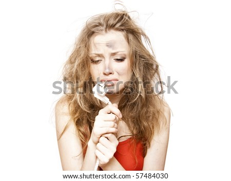 funny woman holds a plug - stock photo