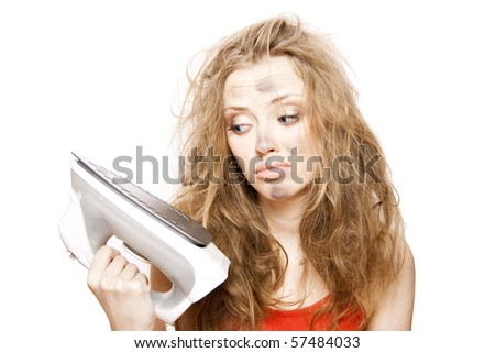 funny woman holds electric iron - stock photo