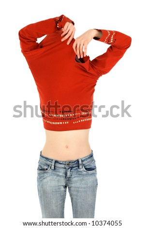 Funny woman in jeans takes off an orange shirt. - stock photo