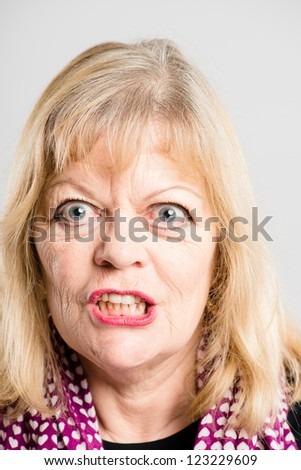 funny woman portrait real people high definition grey background - stock photo