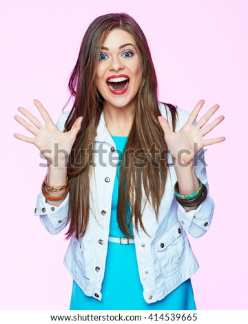 Funny woman portrait with hand on sides. Toothy surprised big smile. Pink background isolated. - stock photo