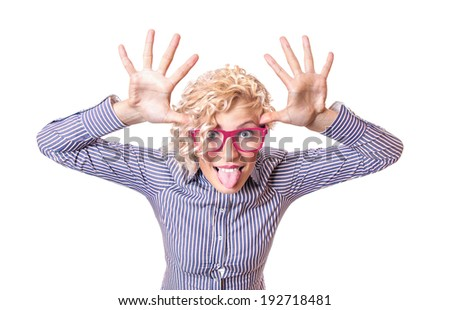 Funny woman pulling a face and sticking his tongue out ,isolated on white background. Close up studio shot of humorous girl - stock photo
