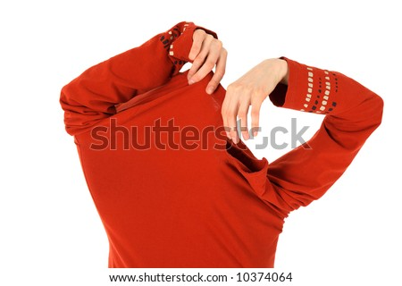 Funny woman takes off a bright orange shirt. - stock photo