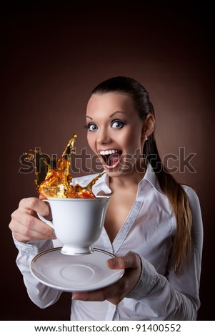 funny Woman with cup and splash of tea smile - stock photo