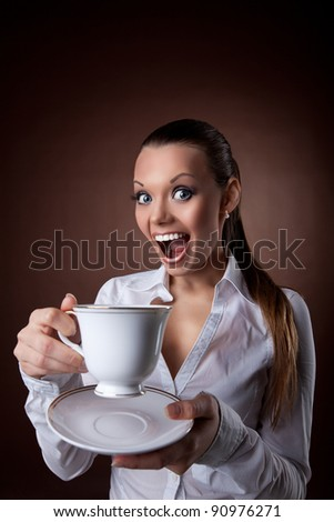 funny Woman with cup of coffee smile at brown - stock photo