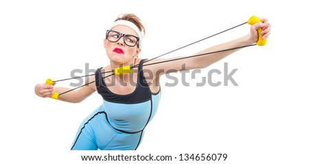 Funny woman with expander, fitness girl stretching over white background - stock photo