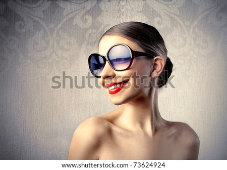 Funny woman with sunglasses - stock photo