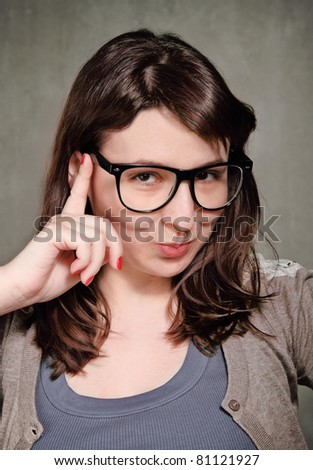 Funny young brunette woman in retro style - stock photo