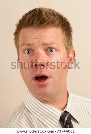 Funny young business man strange silly face - stock photo