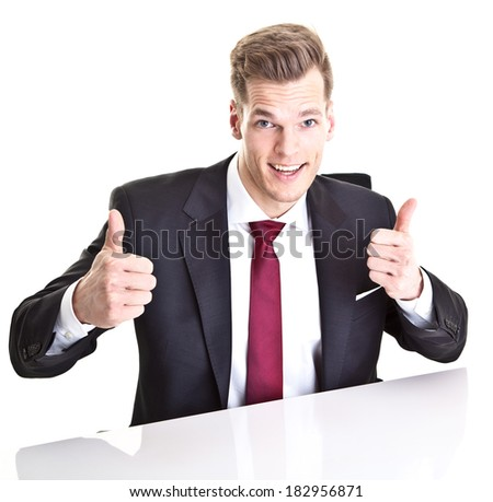 Funny young businessman showing both thumbs up - isolated on white - stock photo