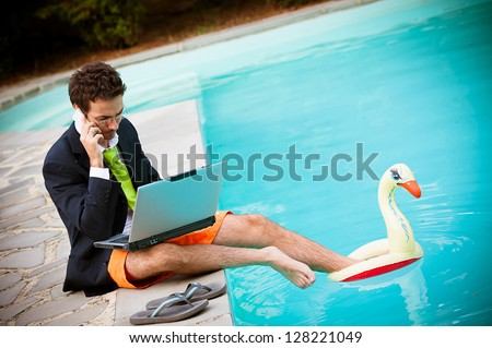 Funny Young Businessman with SwimmingTrunks next to the Pool - stock photo