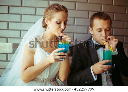 funny young  couple drinking blue  cocktails