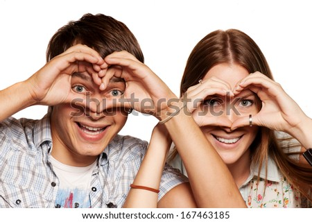 Funny  young couple standing on white background, isolated - stock photo