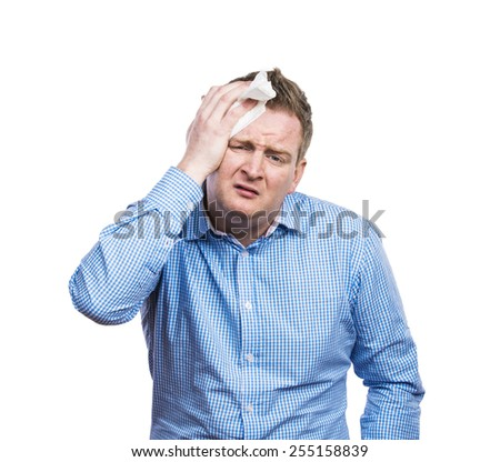 Funny young drunk man with headache. Studio shot on white background.