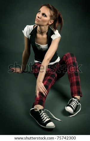 funny young girl on dark background - stock photo