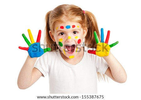 Funny young girl with brightly painted hands. Isolated on white background.