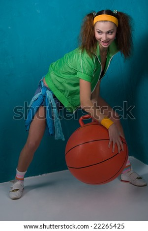 funny young girl with orange fitball is smiling - stock photo