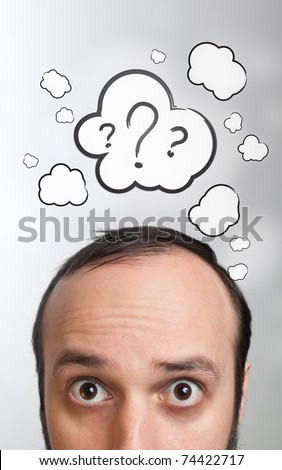 Funny Young guy with question mark over his head - stock photo