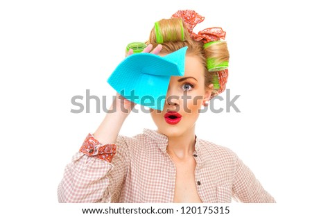 Funny young housewife holding rag / wipe, isolated on white. Pin-up girl