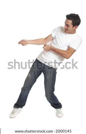 Funny young man over white background / pulling something - stock photo