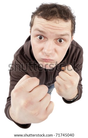 Funny young man punching. Fish-eye lens used. High resolution image taken in studio. Isolated on pure white background.