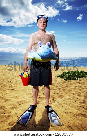 Funny young man ready for fun at sunny beach in Hawaii