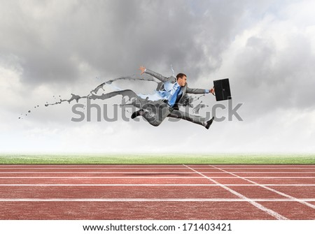 Funny young office worker running in a hurry - stock photo