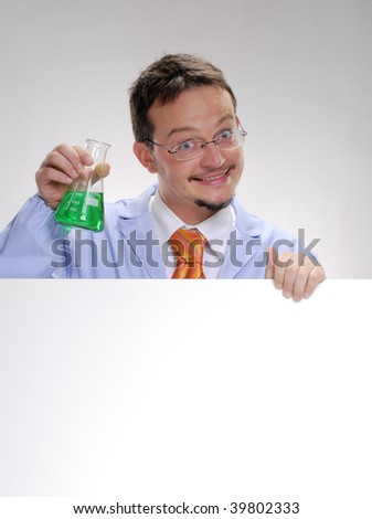 Funny young scientist holding an experimental glass. A doctor holding an experimental formule glass. - stock photo