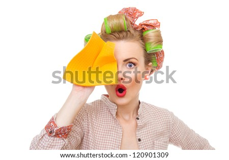 Funny young surprised housewife holding rag / wipe, isolated on white - stock photo