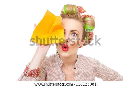 Funny young surprised housewife holding rag / wipe, isolated on white. Pin-up girl - stock photo