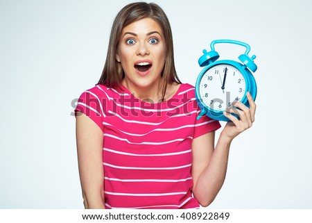 Funny young woman. Isolated concept portrait of woman with watch. - stock photo