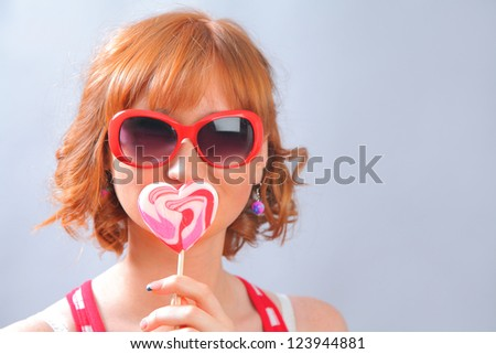 funny young woman with lollipop
