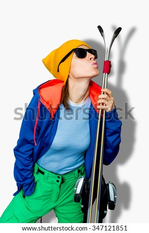 Funny young woman with ski  isolated over white background