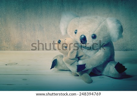 Fur bear and dog toy on grunge still light painting style - stock photo