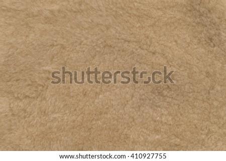 Fur sheepskin beige. Textures, background - stock photo